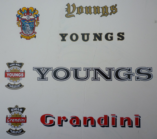 Sets of vinyl transfers made by a sign writing firm applied to a display board