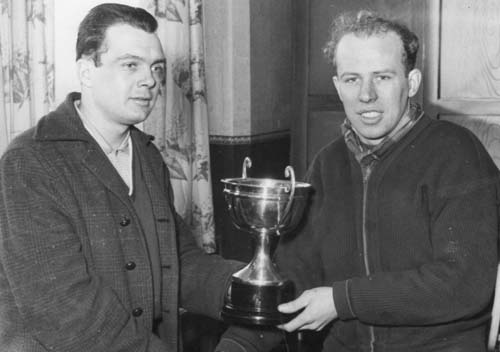 Brian Haskell being presented with the trophy for the 1957 Independant championship by Brian Robinson, his former teammate in the Huddersfield R.C.