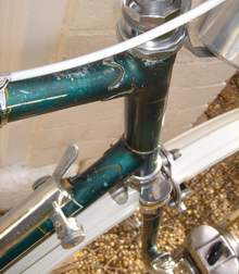Three detail shots of head area showing lugs and original finish with lining