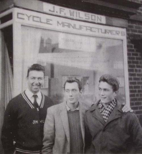 J F Wilson's first shop with owner on left and Roy Hempsall National Junior Champion, 1963 on right