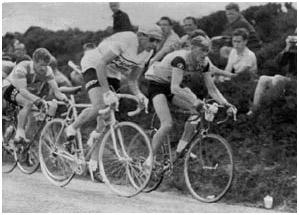 Italian rider, Fausto Coppi (Fanini) alongside Syd Wilson (J.F.Wilson Cycles) in the Manx Premier Professional Road Race on the Isle of Man in 1959